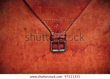 Old leather textured background with a belt