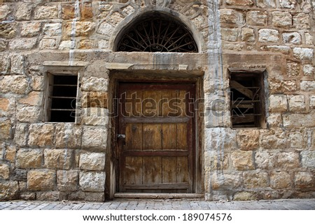 Old Lebanese Wall, Door, and Windows - stock photo