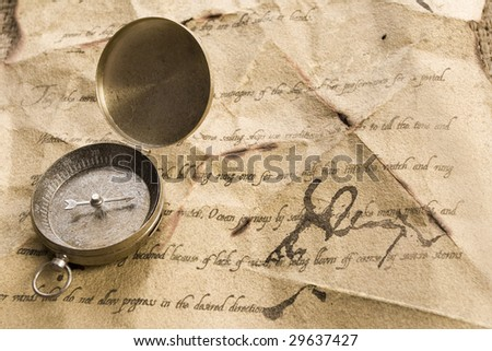 Old letter and golden compass