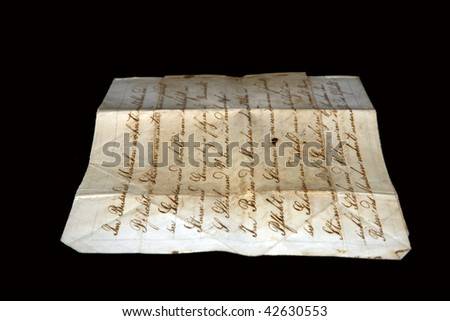 Old letter with cursive scripture on black - stock photo