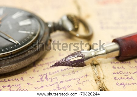 Old letters and pen as a background