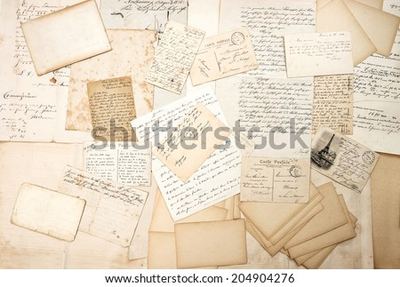 old letters, handwritings and vintage postcards. nostalgic sentimental background. ephemera - stock photo
