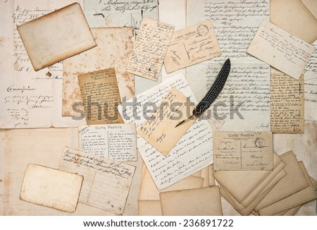 old letters, handwritings, ephemera, vintage postcards and antique feather pen. nostalgic sentimental aged paper background - stock photo