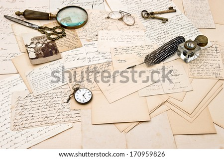 old letters, postcards, vintage accessory and photo of a family. retro style nostalgic background. collectible goods. ephemera - stock photo
