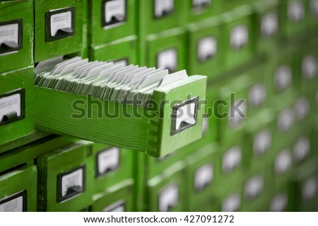Old library or archive reference catalogue with one opened card drawer. Database and knowledge catalog concept. - stock photo