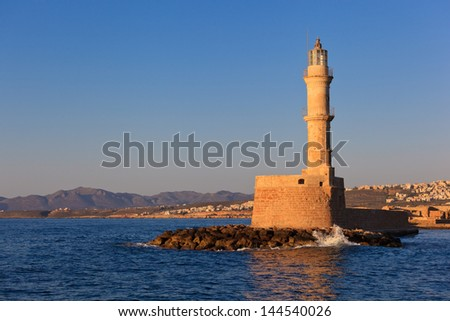 Old lighthouse at Chania on the greek island of Crete - stock photo