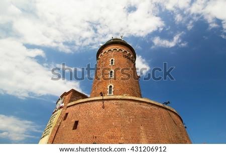 Old lighthouse in Kolobrzeg city, Poland - stock photo