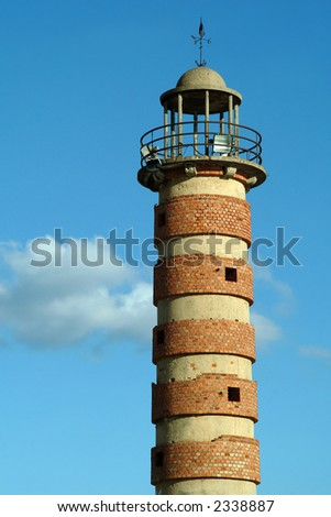 Old lighthouse made in brick disactivated in Lisbon - stock photo