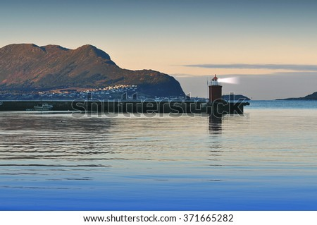 Old lighthouse on sea coast in Alesund - Norway - Toned picture - stock photo
