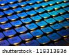 Old lipstick tone numbers on a blue light - stock photo