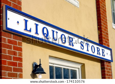 Old Liquor Store sign - stock photo