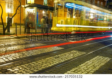 Old Lisbon tram rails in late evening. - stock photo