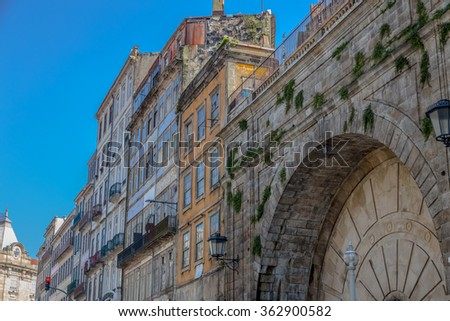 Old living building near an unattended monument in Porto. - stock photo
