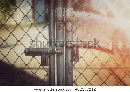 Old lock and mesh fence, process vintage tone