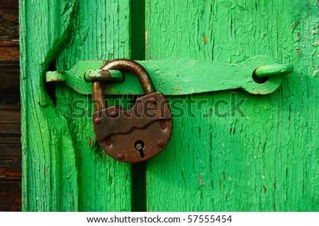 old lock and old green door - stock photo