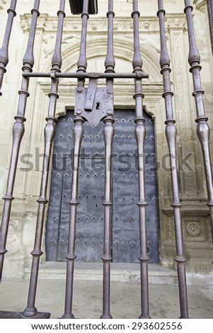 Old lock on a metal gate, old Christian church, decoration and protection - stock photo