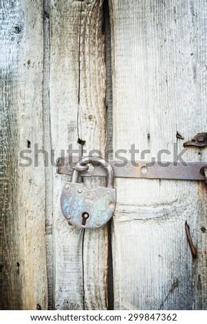Old lock on the door. lock on the door of an old farmhouse . true village style . close-up. focus on lock - stock photo