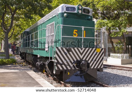 Old Locomotive train in green situated in Hong Kong, China - stock photo