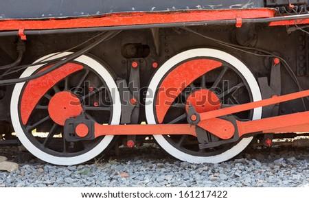 Old locomotive wheels. - stock photo
