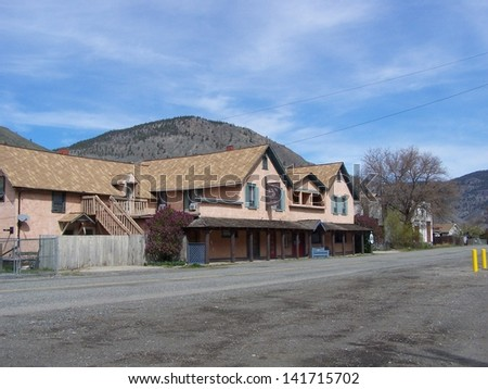 Old lodging in the hills - stock photo