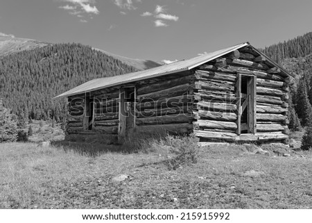 Old log cabin from an abandoned mining town in the rocky mountains, USA - stock photo