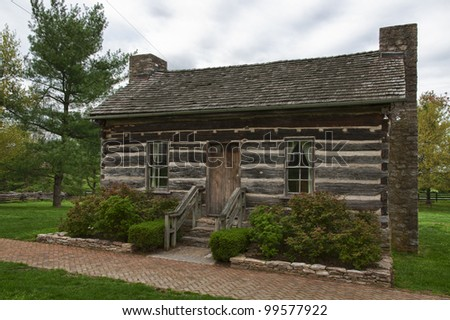 Old log cabin in Waveland State Historic Site . Lexington, Kentucky, USA - stock photo