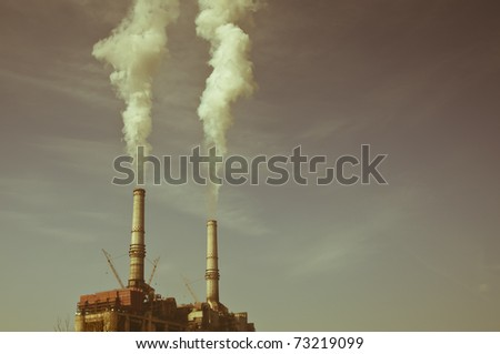 Old looking coal burning plant - stock photo