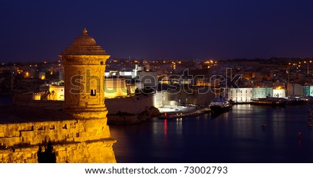 Old lookout tower at Valetta fortress in night. Malta - stock photo