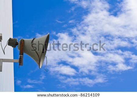 Old  loudspeaker against cloudy blue sky - stock photo