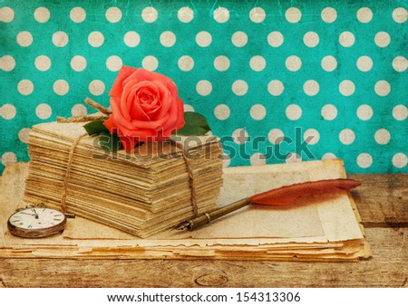 old love letters and postcards with pink rose flower isolated on white background. Nostalgic sentimental still life. Retro style designed picture - stock photo