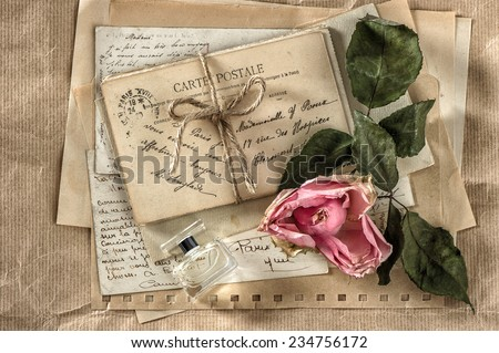 old love letters, perfume and dried rose flower. nostalgic sentimental scrapbook paper background - stock photo