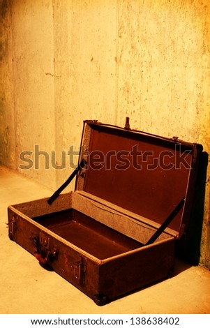 old luggage against grunge background - stock photo