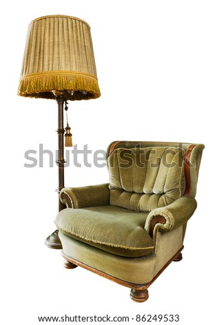 Old luxury armchair made from wood and fabric with floor lamp - stock photo