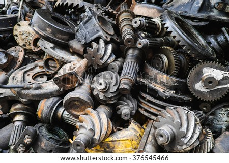 Old machine parts in second hand machinery shop - stock photo