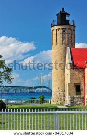 Old Mackinac Point Lighthouse - Mackinaw City, Michigan Mackinac Bridge in the background - stock photo