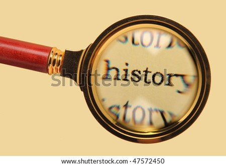 Old magnifying glass enlarged word history - stock photo