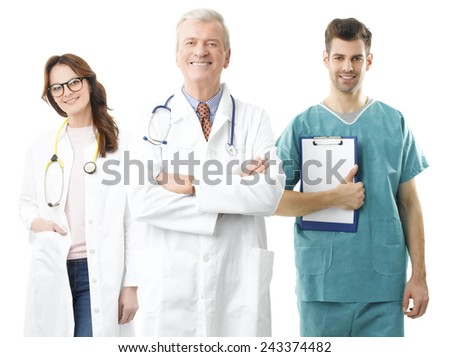 Old male doctor with his medical team standing against white background.  - stock photo