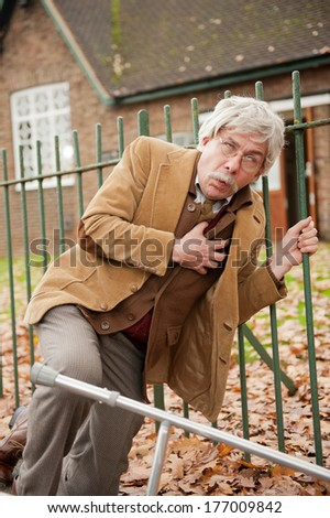 Old Man Falling Down With Chest Pains - stock photo