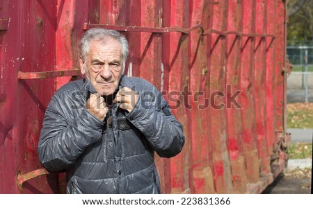 old man getting cold outside - stock photo
