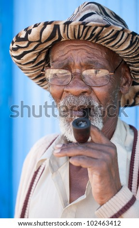 Old man having a serious look on his face - stock photo