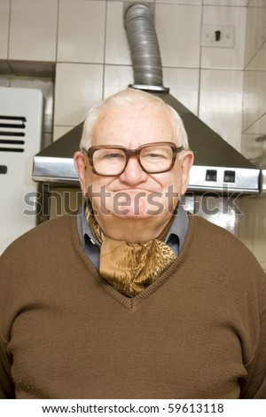 old man in the kitchen - stock photo