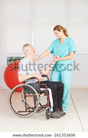 Old man in wheelchair at physiotherapy in a nursing home
