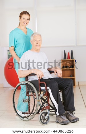 Old man in wheelchair with geriatic nurse in a nursing home - stock photo