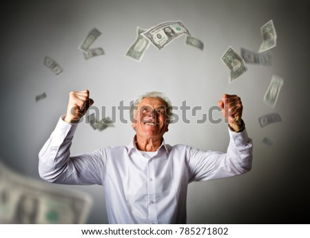 Old man in white and falling dollar banknotes. Currency and lottery concept.