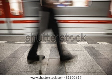 Old man is going to subway. - stock photo