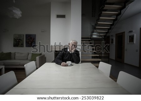 Old man lonely in a big empty house