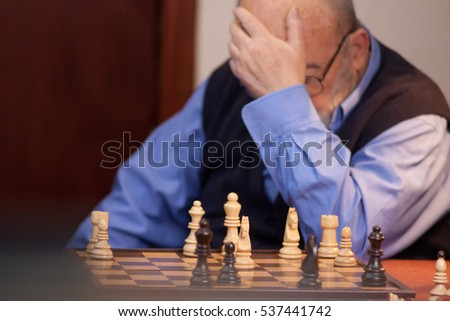 old man losing chess match