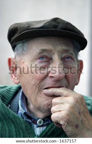 Old man meditating - stock photo