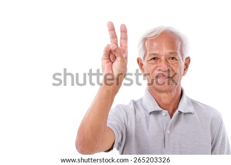 old man raising 2 fingers, victory gesture - stock photo