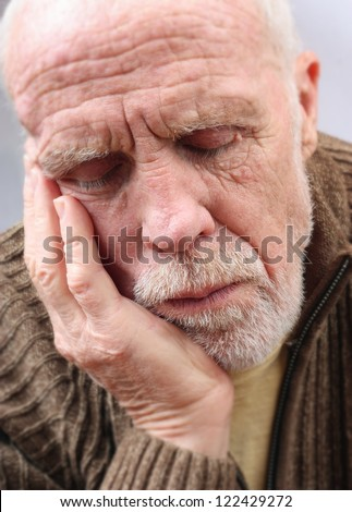 Old Man Resting - stock photo